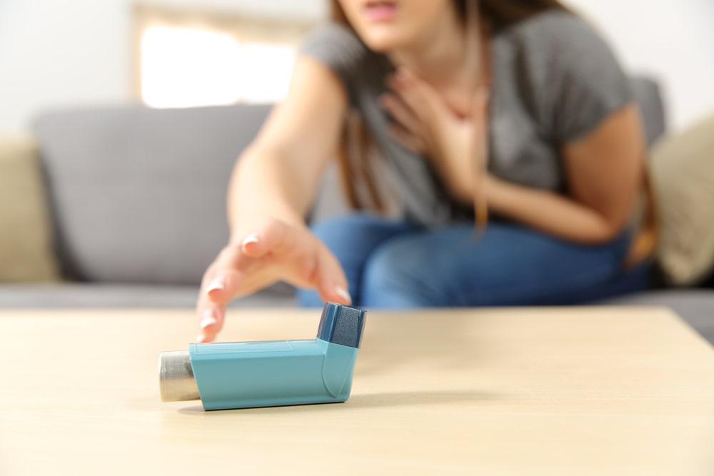 Women Trying To Pick Asthma Pump